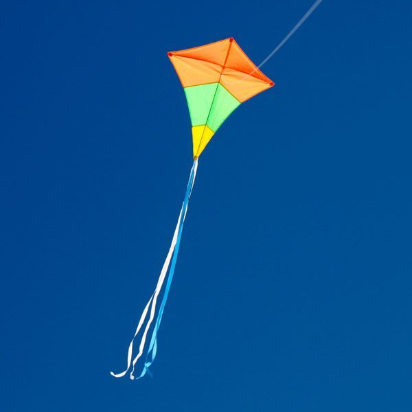 Australian made diamond tricolour single string kite flying in the distance to show long tails