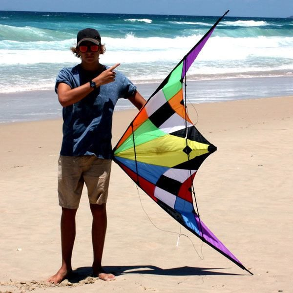 Teenager holding Firestorm stunt kite to show 1.83 metre size