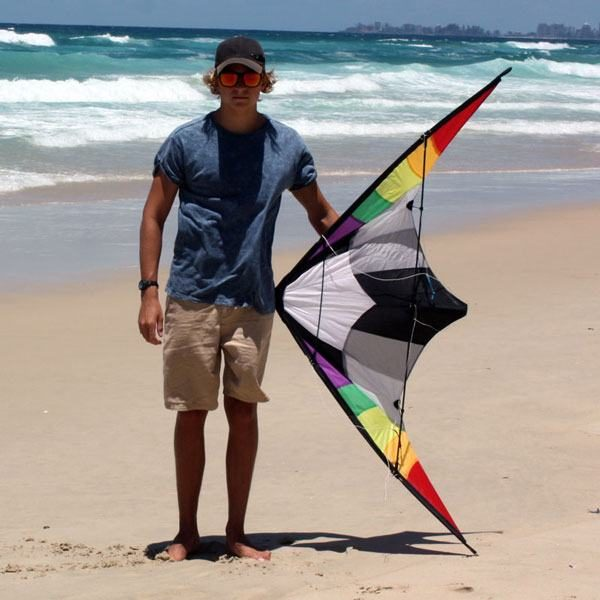 Teenager holding 1.6m Ikon stunt kite to show size