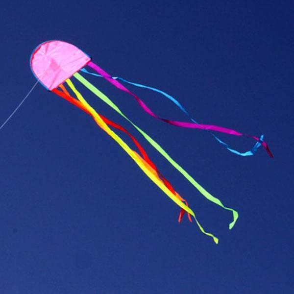 Jellyfish kite flying against blue sky