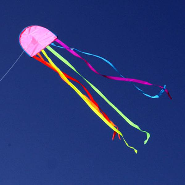 Jellyfish kite flying against blue sky