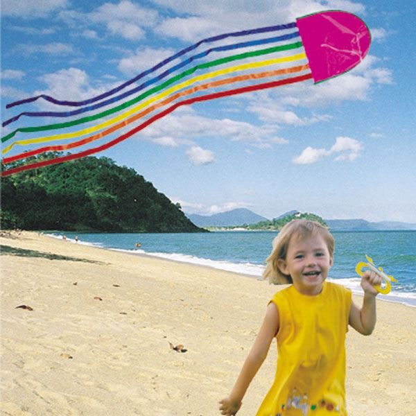 Young gild on the beach flying her Australian made Jellyfish kite