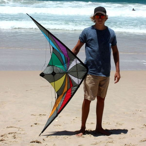Backdraft dual control stunt kite beside adult to show size
