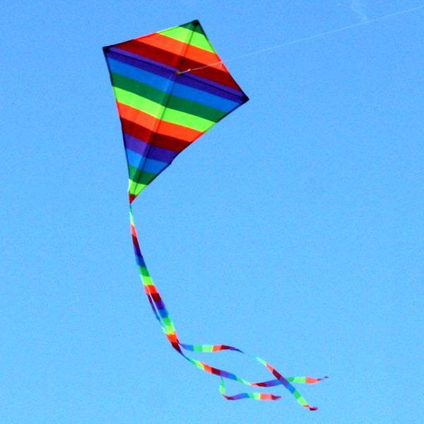 small Rainbow Diamond kite for kids doing circles in the sky