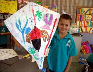 Boy holding his make your own workshop kite