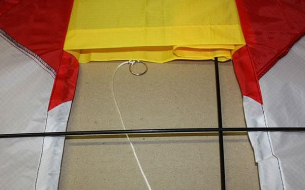 Rainbow Cell single string kite close up showing rods and bridle ring