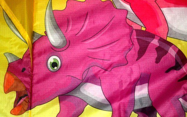 Dinosaur printed delta kite close up showing triceratops