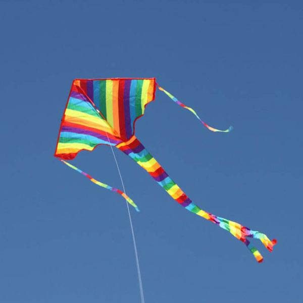 Rainbow delta single string kite flying in the distance