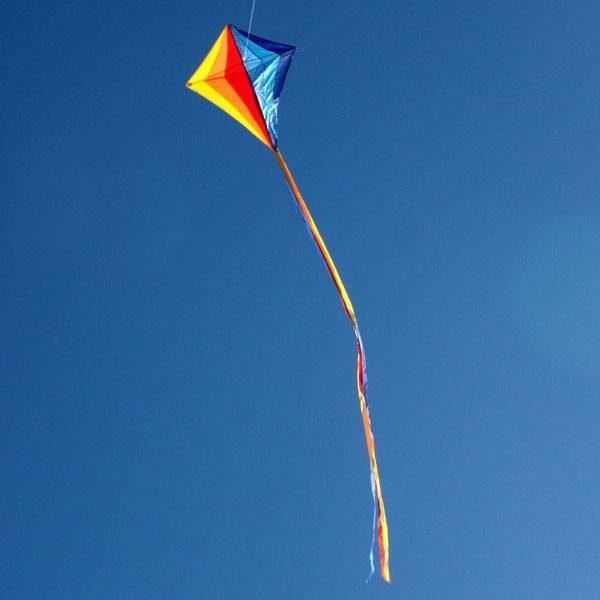 sparkles kids diamond kite flying in the distance