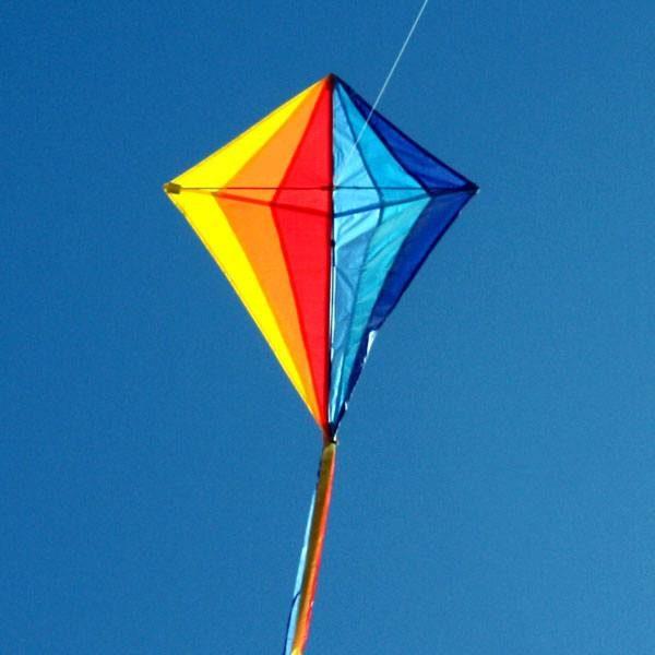 Sparkles kids diamond kite flying in sunlight