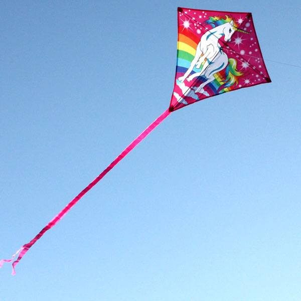 Unicorn diamond kite for children flying in the distance to show long tails